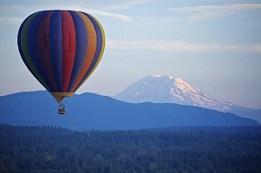 Hot air balloon above mountains